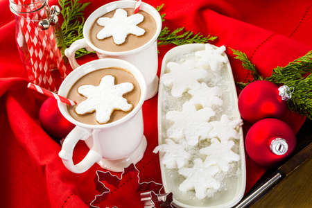 Homemade hot chocolate garnished with snowflake shaped white marshmallows. photo