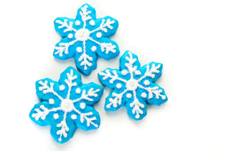 jewish home: Frosted blue sugar cookies in shape of snowflakes.