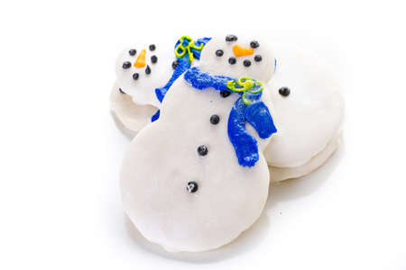 jewish home: Frosted white sugar cookies in shape of snowman. Stock Photo