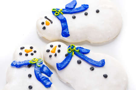 khanukah: Frosted white sugar cookies in shape of snowman. Stock Photo