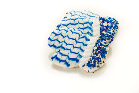 jewish home: Frosted white and blue sugar cookies in shape of winter mittens. Stock Photo