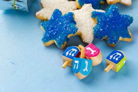 dreidels: Hanukkah white and blue stars hand frosted sugar cookies,