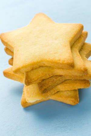 Sugar cookies in shape eof stars on blue background.