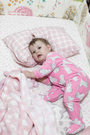 matress: Cute toddler girl waking up from her nap. Stock Photo