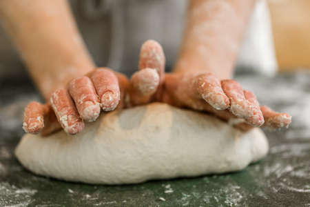 Young baker preparing artisan sourdough bread. Stock Photo