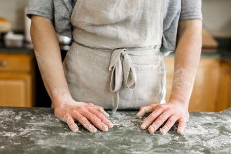 baker: Young baker preparing artisan sourdough bread. Stock Photo