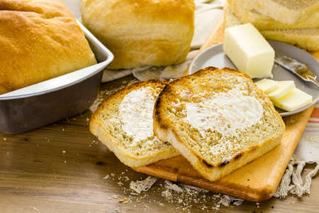 Toasted slices of freshly baked sourdough bread with butter. Imagens - 35458916