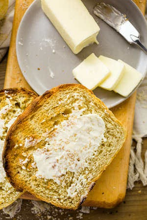 craftsperson: Toasted slices of freshly baked sourdough bread with butter. Stock Photo