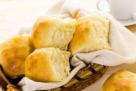 Freshly baked sourdough dinner rolls on the table.
