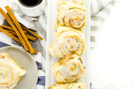 energizing: Freshly baked sourdough cinnamon rolls on a white background.