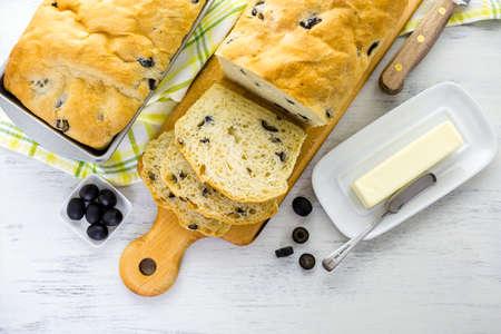 Fresh artisan sourdough olive bread on the table.