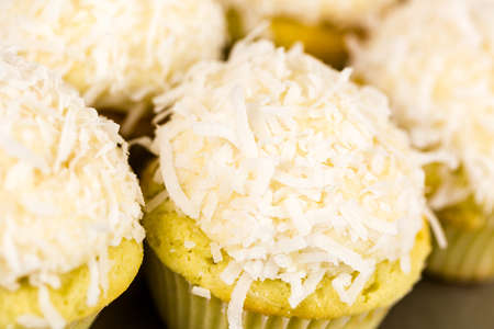 pastrie: Fresh coconut cupcakes on the tray. Stock Photo