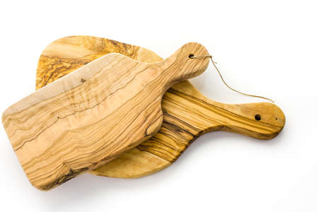 Olive wood cutting board on a white background. Imagens