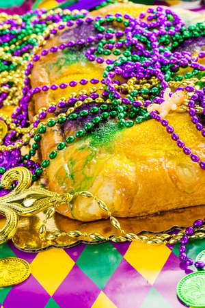 fat tuesday: Freshly baked cheese King Cake for celebrating Mardi Gras. Stock Photo