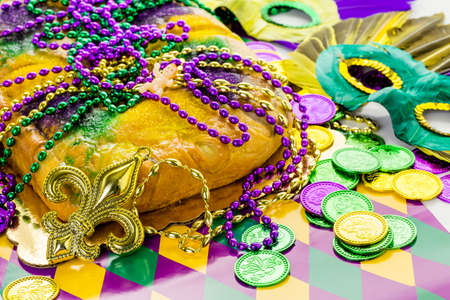 party food: Freshly baked cheese King Cake for celebrating Mardi Gras. Stock Photo