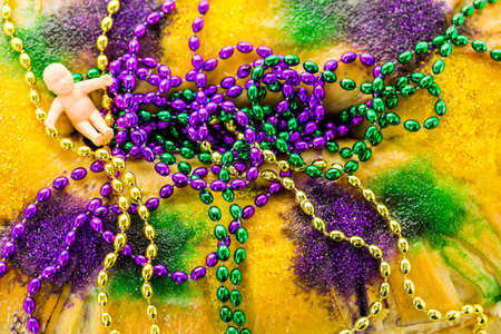 mardi gras: Freshly baked cheese King Cake for celebrating Mardi Gras. Stock Photo