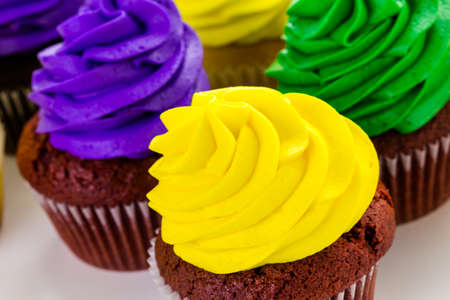 shrove: Cupcakes decorated with bright color icing for Mardi Gras party.