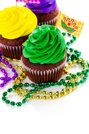 Cupcakes decorated with bright color icing for Mardi Gras party.
