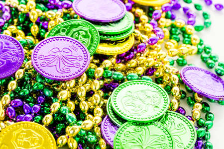 fat tuesday: Multicolored decorations for Mardi Gras party on the table.