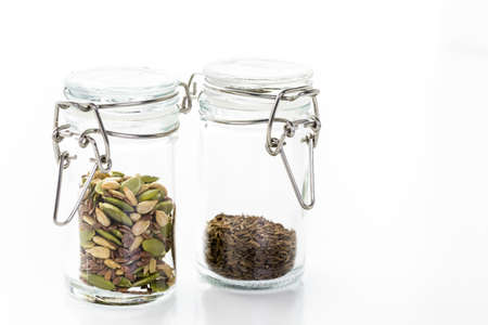 Dry seeds for baking bread in small glass jars. Zdjęcie Seryjne
