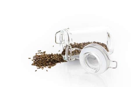 Dry seeds for baking bread in small glass jars. Reklamní fotografie