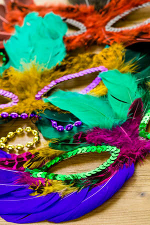 shrove: Multicolored decorations for Mardi Gras party on the table.