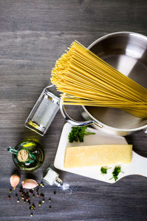 boiling: Cooking organic pasta with garlic herbs and parmesan cheese. Stock Photo