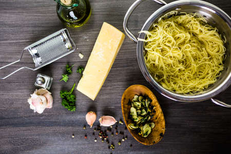 cooking oil: Cooking organic pasta with garlic herbs and parmesan cheese. Stock Photo