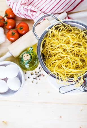 grader: Cooking organic spaghetty for dinner.