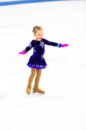 figure skater: Young figure skater practicing before her first ccompetition.