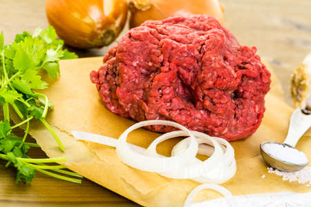ground beef: Ground beef on the table with other ingredients for recipe.