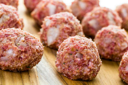 Raw Italian meatballs ready to be cooked for dinner.