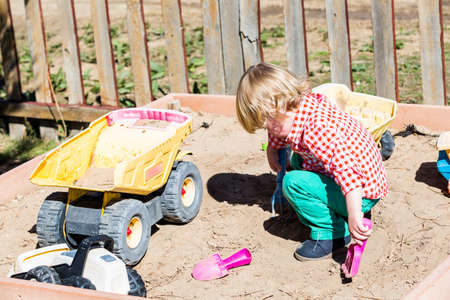 sandpit: Second birthday party at the community farm. Stock Photo