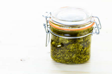 Homemade basil pesto sauce with fresh ingredients. Stock Photo