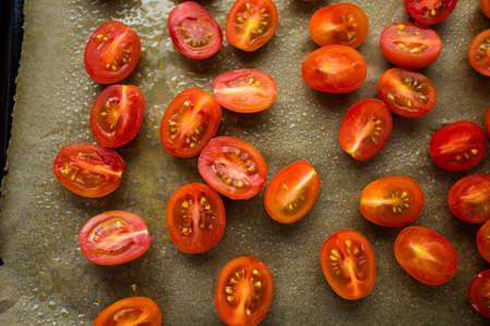 Preparing fresh roasted cherry tomatoes.