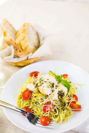 angel hair: Homemade angel hair pasta with pesto sauce, roasted cherry tomatoes and grilled chicken.