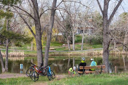 denver parks: Denver, Colorado, USA-April 11, 2015. Family on bike ride in urban park on weekend.