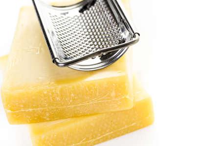 gruyere: Bloccks of gruyere cheese on a white background. Stock Photo