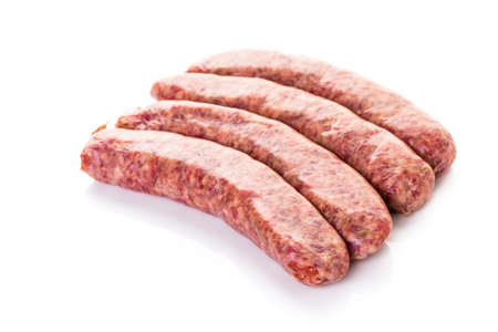 Raw Italian sausage on a white background. Banco de Imagens