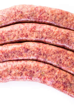 italian sausage: Raw Italian sausage on a white .