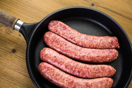 italian sausage: Cooking Italian sausage on a frying pan.