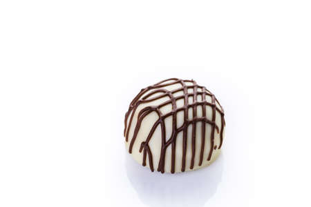 indulgence: Chocolate truffles on a white background.