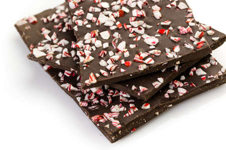 Choolate bark with peppermint on a white background.