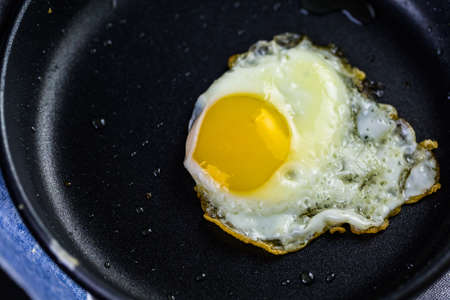 frying pan: Cryspy egg on small frying pan.