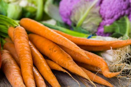 caulis: Fresh organic vegetable in season on old farm table.