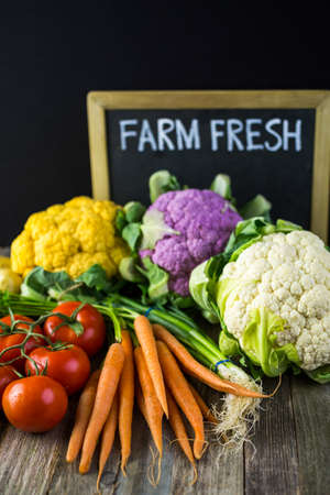 old farm: Fresh organic vegetable in season on old farm table.