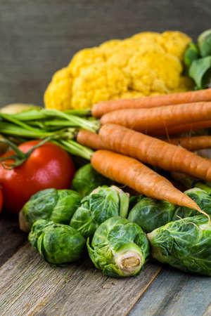 etymology: Fresh organic vegetable in season on old farm table.