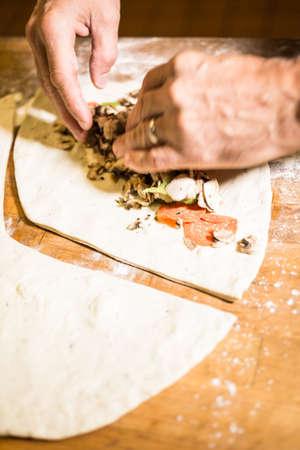 pepperoni: Preparing Pepperoni calzone in Italian restaurant.