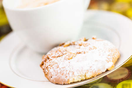 baked treat: Hot coffee with Southern Italian ccookie on the table. Stock Photo