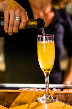 bellini: Bartender making Bellini cocktail in Italian restaurant. Stock Photo